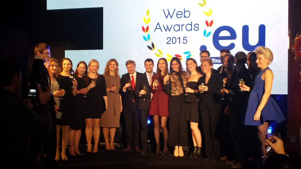 Our collegues Penelope Baltzoi and Konstantina Fotia stand on the stage with the winners of EURid WEB AWARDS 2015!